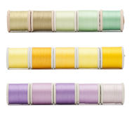 Three horizontal border rows of sewing threads Royalty Free Stock Images