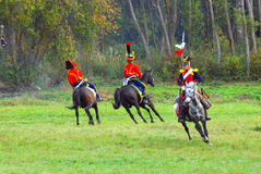Three horse riders. Stock Images