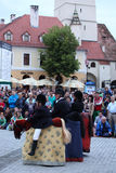 Three horsemen talking to people around them. Sibiu, Romania - June 11, 2013: Sibiu International Theatre Festival. The Horsemen show presented by Les Goulus Royalty Free Stock Photo