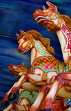 Three horses of a Carousel Stock Image