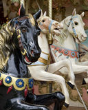 Three horses on fairground carousel Stock Images