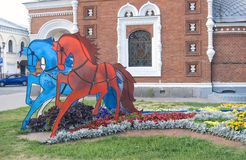Three horses - red, blue and white. Royalty Free Stock Photography