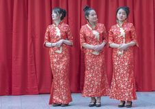 Chinese New Year 2019 - three hostesses. Three hostesses discussing during the Chinese new year celebration in the city hall premise celebrating the Chinese new stock photos