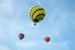 Three Hot Air Balloons. Floating in a cloudy sky Stock Images