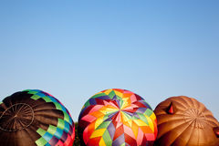 Three Hot air balloons being inflated Stock Images