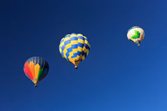 Three hot air balloons with blue sky. Stock Images