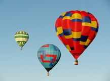 Three hot air balloons in blue sky Royalty Free Stock Photo