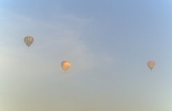 Three hot air balloons in the morning mist Royalty Free Stock Images
