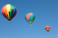 Three hot air balloons on a sky blue backgroun Royalty Free Stock Photography