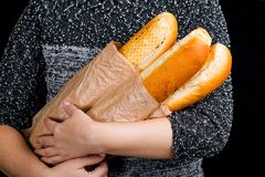 Three hot baguette in hand Stock Photography