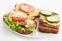 Three hot chicken and ham sandwiches Royalty Free Stock Images