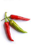 Three hot chili peppers  Stock Photo