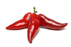 Three hot chilli peppers Stock Photography