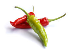 Three hot chilli peppers Stock Photo
