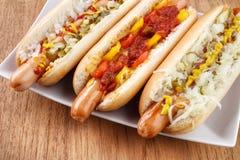 Three hot dogs closeup Royalty Free Stock Photos