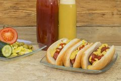 Three hot dogs with ketchup and mustard Royalty Free Stock Photos