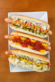 Three hot dogs Stock Image