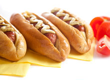 Three hot dogs with tomato Stock Photography