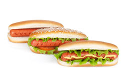 Three hot dogs with various ingredients Royalty Free Stock Photo