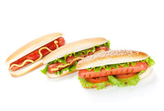 Three hot dogs with various ingredients Royalty Free Stock Photos