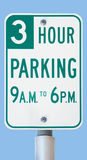 Three-hour parking sign. Actual street parking sign in a city against a clear blue sky Stock Photo