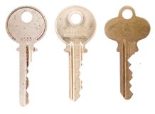 Three house keys on white Royalty Free Stock Photo