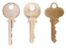 Three house keys on white Royalty Free Stock Photo