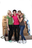 Three housemates moving Royalty Free Stock Photos