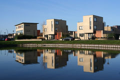 Three houses. And their reflections in a modern suburb stock photos