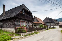 Three houses in Cicmany village. Cicmany, Slovakia - august 02, 2015: Old wooden houses in Slovakia village Cicmany, traditional painted with white paint Stock Image