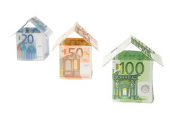 Three houses made of euro paper money. Three houses made of 20, 50 and 100 euro notes Stock Photo