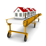 Three houses are moving on conveyor belt Stock Photo