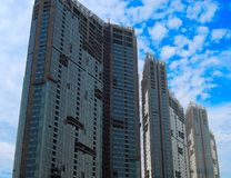 Three houses under construction. Against cloudy sky Royalty Free Stock Photography
