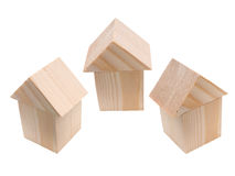 Three houses of wooden building blocks Royalty Free Stock Image