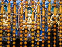 Buddha statue in Namdroling Monastery. Three huge statues of Lord Buddha called Padmasambhava, Buddha and Amitayus inside Namdroling Monastery in Kushalnagar Stock Image