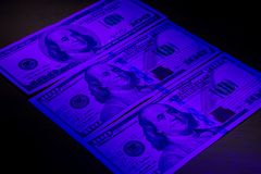 Three hundred dollar bills Stock Photo