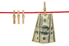 Three hundred dollars. Dollars are hanging on a wooden clothespin isolated on white background Royalty Free Stock Images
