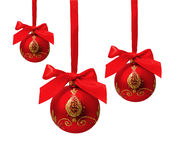 Three hunging red christmas balls isolated Stock Photo