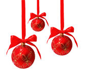 Three hunging red christmas balls isolated Royalty Free Stock Photography