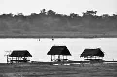 Three hut on water Stock Images