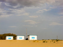 Three huts on a beach. Dramatic weather in Larache, Morocco Royalty Free Stock Photography