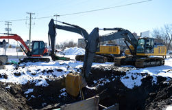 Three Hydraulic diggers and excavators Stock Photos