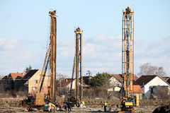 Three hydraulic drilling machines and workers Royalty Free Stock Image