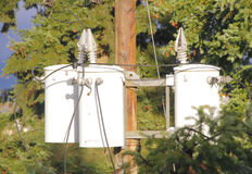 Three Hydro Transformers on Pole Stock Photo