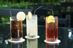 Three ice cold drinks Stock Photos