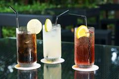 Three ice cold drinks Stock Photos