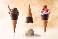 Three ice cream cone different tastes summer fun. Concept summer funny ice cream. With upside down and ice cream and crushed ice cream ball on the table royalty free stock image