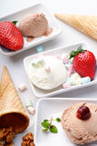 Three ice cream sundaes , waffle cone and walnuts Stock Images