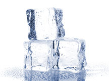 Three ice cubes with water drops Stock Photo