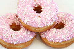 Three Iced Donuts. Close up of three iced donuts with sprinkles stock photography